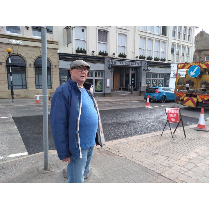 Cllr Davies at the crossing on Railway Rd